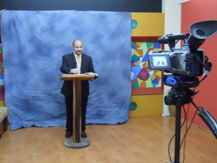 Pastor Franco Loyola teaches The Doctrine of God in borrowed television studio in Santo Domingo Ecuador